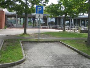 Wheelchair-accessible parking in front of Building 8